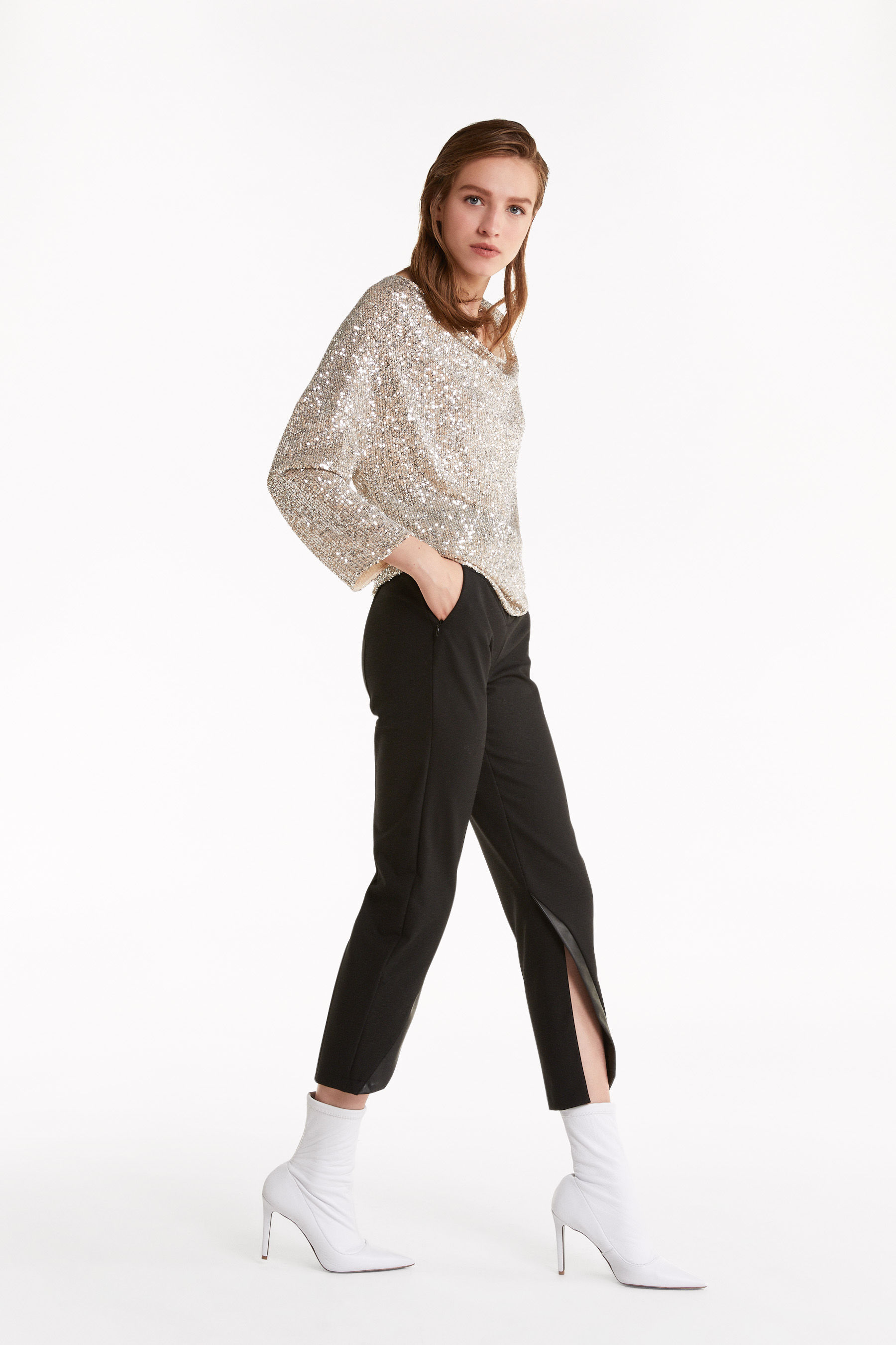 Trousers with faux leather inserts